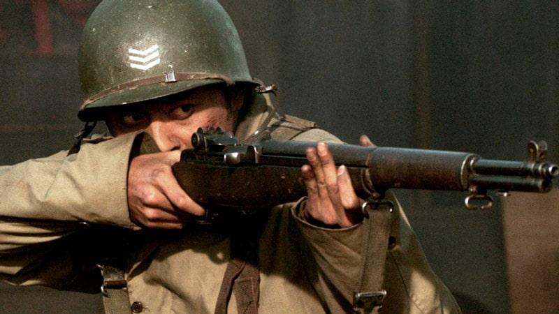 Jang Dong Gun tient à fusil