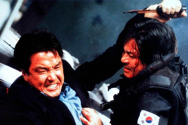 Han Suk-Gyu et Choi Min-Sik dans Shiri